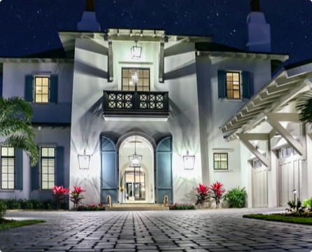 Well lit luxury home entrance at night